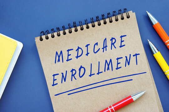 Conceptual photo about Medicare Enrollment with handwritten text.