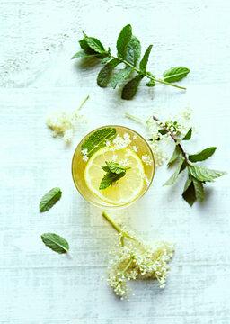 Homemade Elderflower-Ginger Lemonade with Mint leaves. Healthy summertime drinks