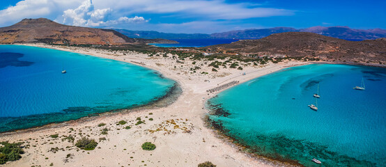 Aerial view of Simos beach in Elafonisos island in Greece. Elafonisos is a small Greek island the Peloponnese with idyllic exotic beaches and crystal clear waters. Laconia, Greece, Europe