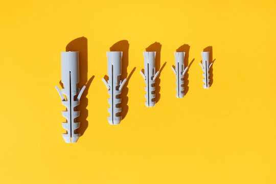 Set of dowels on yellow background with shades
