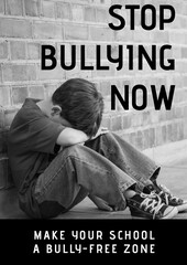 Fototapeta Composition of anti bullying text with crying schoolboy in black and white obraz