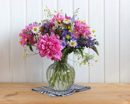 garden and wild flowers and herbs in a glass vase.