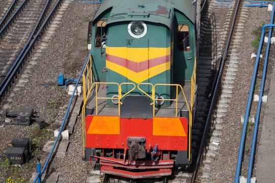 Diesel locomotive is on a railway