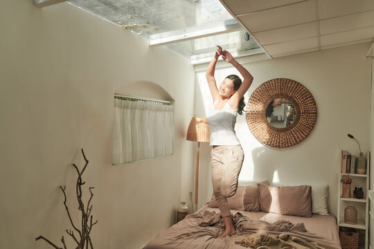 Woman dancing in morning at home.
