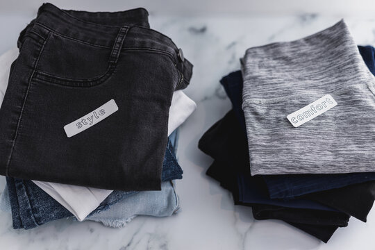 piles of jeans and pants being sorted into Style vs Comfort categories, decluttering and prioritizing looking good or feeling good