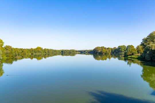 Beautiful panorama of the lake landscape on a summer day in the Fuldaaue in Kassel, Germany