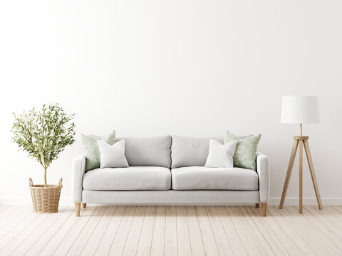 Traditional living room interior mockup with grey sofa and green pillows by olive tree in wicker basket and floor lamp on empty white wall background. 3d rendering, illustration