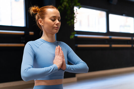 Tranquil woman meditating in yoga pose