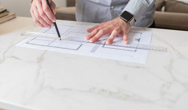 Man making construction plan on desk