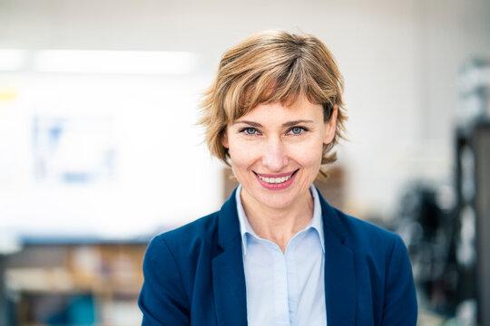Smiling female entrepreneur at workshop