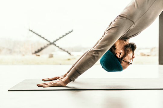 Male yoga teacher practicing yoga