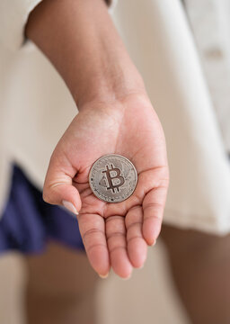 Young Afro-American girl interacting with cryptocurrencies,bitcoin Silver Gipuzkoa, Spain.