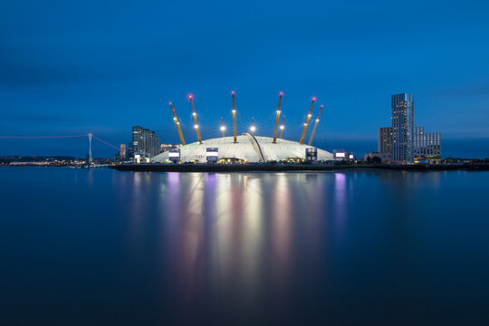 UK, England, London, Long exposure of River Thames and O2 Arena at dusk