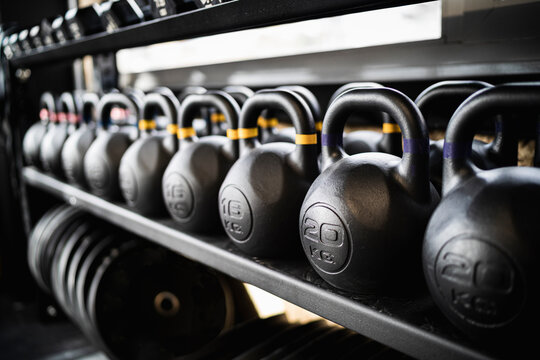 Row of kettlebells on gym rack