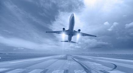 Fototapeta White Passenger plane fly up over take-off runway from airport  obraz