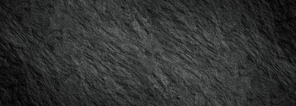 Rock texture with cracks,black stone background with copy space for design.