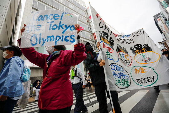 Anti-Olympics group's members carry banners during their protest march, in Tokyo