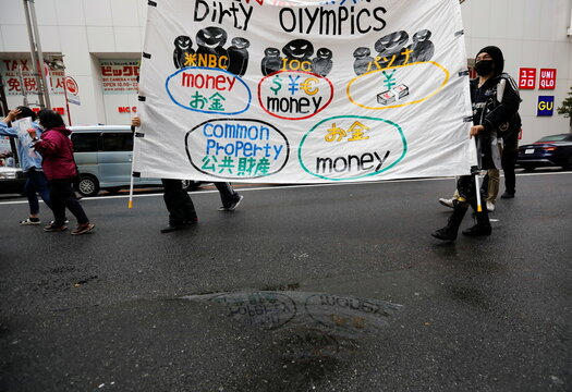 Anti-Olympics group's members display a banner during their protest march, in Tokyo