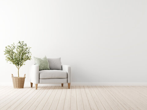 Traditional living room interior mockup with grey armchair and green pillow standing by olive tree in wicker basket on empty white wall background. 3d rendering, illustration