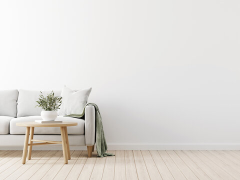 Traditional living room interior mockup with grey sofa, green throw, pillow and wooden  coffee table with olive twigs in vase on empty white wall background. 3d rendering, illustration