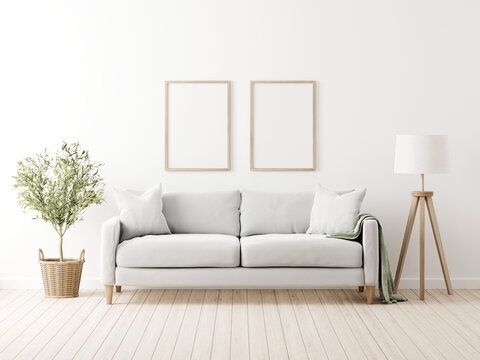 Vertical poster mockup with two frames in living room interior with grey sofa, pillows, throw, green olive tree in wicker basket and floor lamp on empty wall background. 3D rendering, illustration