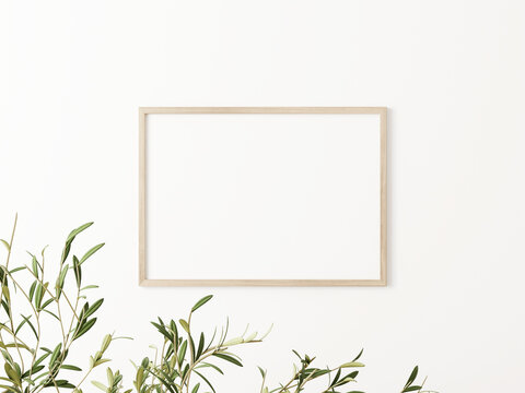 Minimalist horizontal wooden frame mockup with green olive tree branches on empty white wall background. A4, A3, A size, 3D rendering, illustration