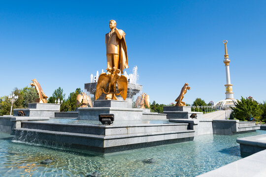 Saparmurat Niyazov statue of gold and Independence Monument in Ashgabat, Turkmenistan. First turkmen president, also know as Turkmenbashi.