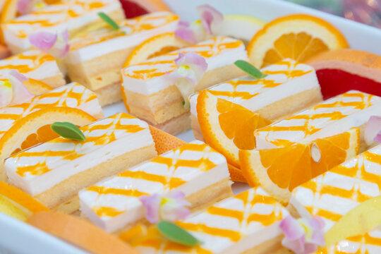 Rare cheesecake with orange sauce
