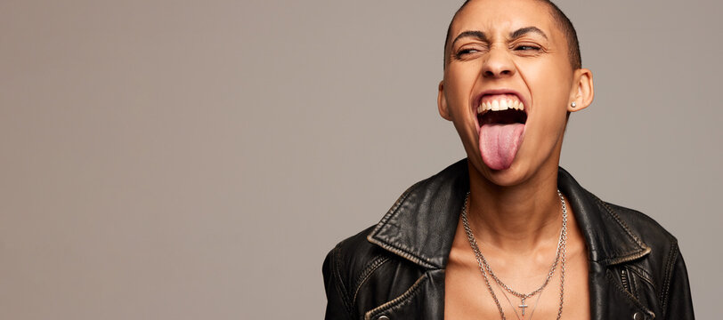 Expressive woman with shaved head