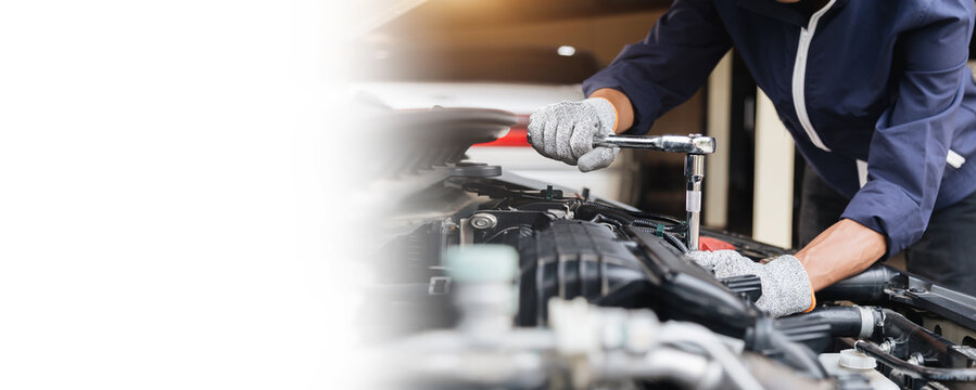 Automobile mechanic repairman hands repairing a car engine automotive workshop with a wrench, car service and maintenance ,Repair service.