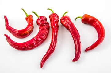 Red hot chili peppers on a white background.