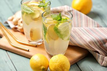 Glasses of cold ginger lemonade on table