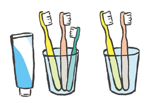 コップに立てた歯ブラシ