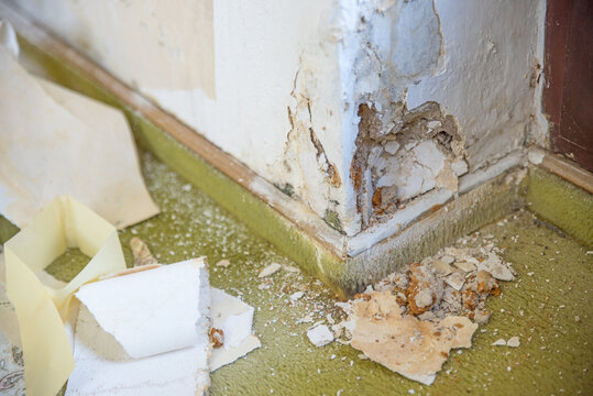 Water damage and big hole in the wall from rising capillary moisture. Renovation of an old building