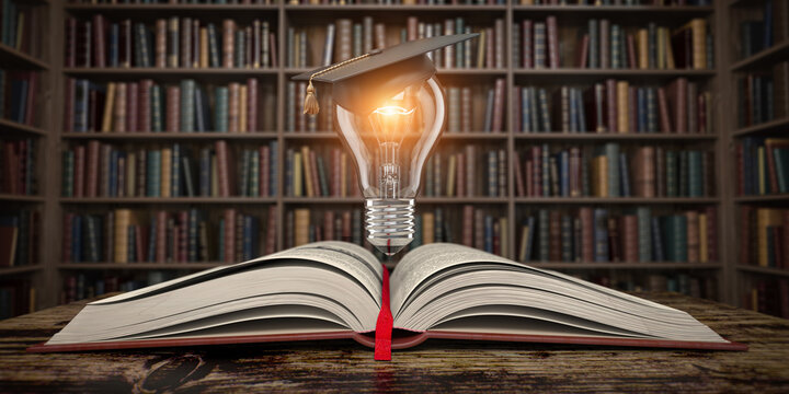 Education, knowledge and innovation concept background. Light bulb with mortar board on open book in vintage library.