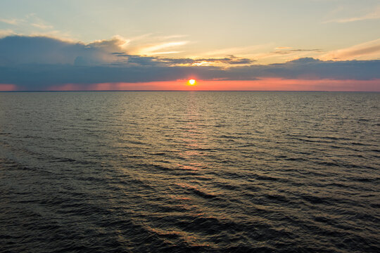 sunset over the sea with many waves