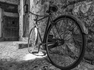Old Bicycle in an alley of an Italian village