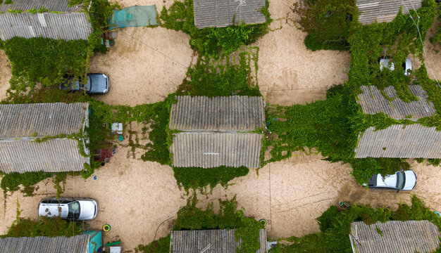 Aerial. Authentic roofs of holiday houses by the sea. Top view from drone.