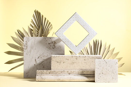 Abstract modern still life. Natural materials. Composition of palm leaves, travertine and concrete blocks.