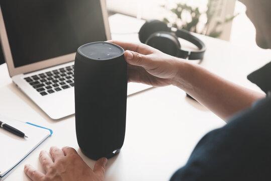 Man using smart speaker. Smart home assistant