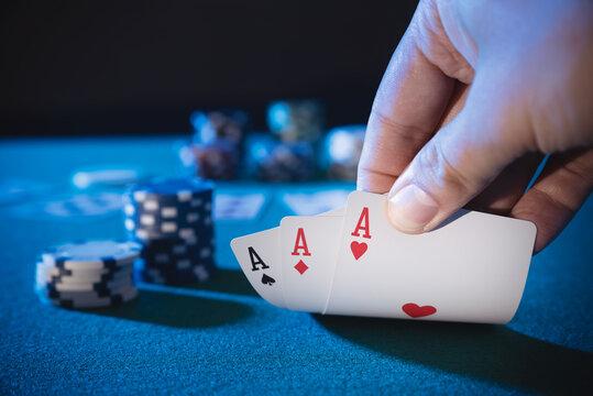 Hand picks up cards, plays casino poker
