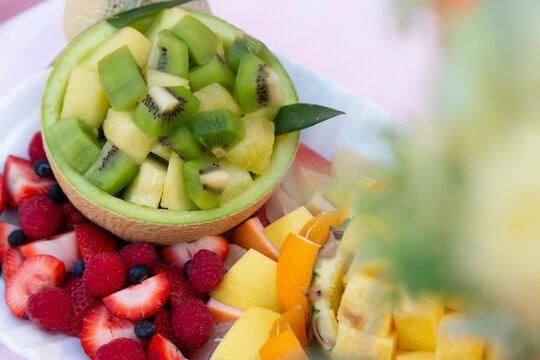 Kiwi, strawberry, melon and pineapple fruit platter