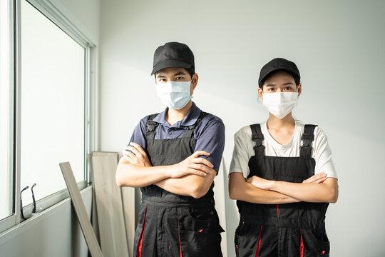 Portrait of Asian construction worker people wear work helmet and mask