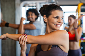 Close up image of attractive fit woman in gym - fototapety na wymiar