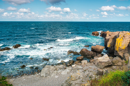 seascape of sozopol, bulgaria. wonderful scenery with cliffs in evening light. sunny weather with clouds above horizon. popular travel destination in summer