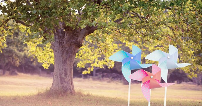 Composition of colourful windmills over trees