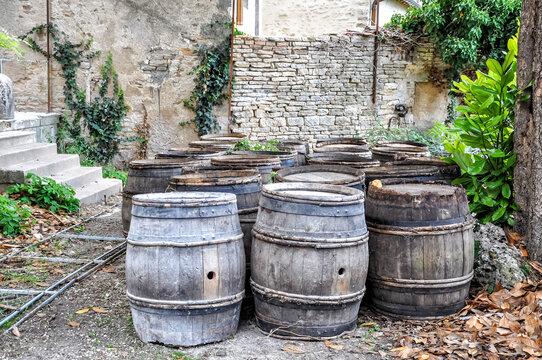 The Burgundian feeling Old wine barrels in a vineyard