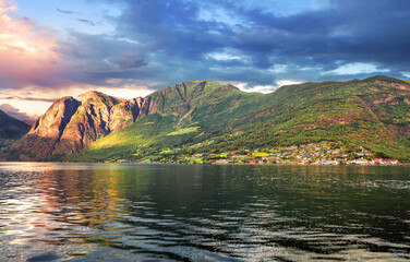 Picturesque landscape of shoreline with small village. Sognefjord. Flam, Aurlandfjord, Norway