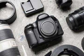 Modern photographer's equipment on grunge background, closeup