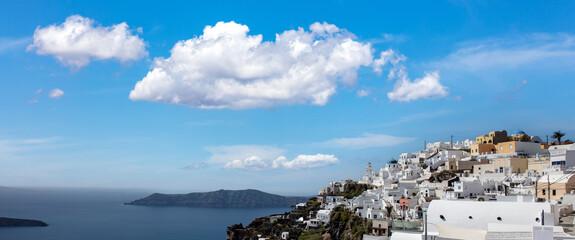 Santorini island, Greece. Fira village caldera over Aegean sea, blue sky, calm sea